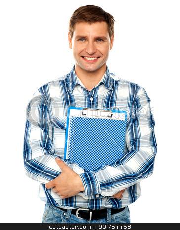 Young man holding clipboard and notepad stock photo, Stylish young man holding clipboard and notepad. Arms crossed by Ishay Botbol