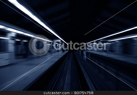 Speedy trains stock photo, Speedy trains passing train station. Focus on the rail road.  by szefei