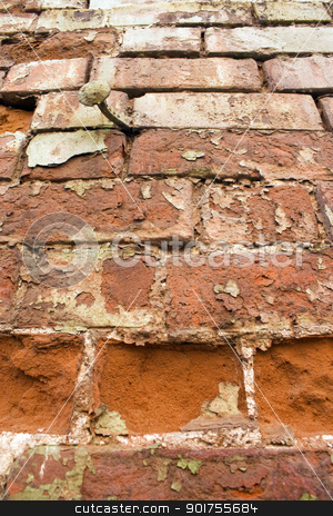 Old wall. stock photo, Old wall with the large metal nail. by Yury Ponomarev
