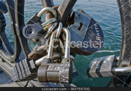 Locks on a lattice. stock photo, Metal lattice with locks. by Yury Ponomarev