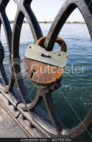 Metal lattice with locks. stock photo, The large old lock on a metal lattice. by Yury Ponomarev