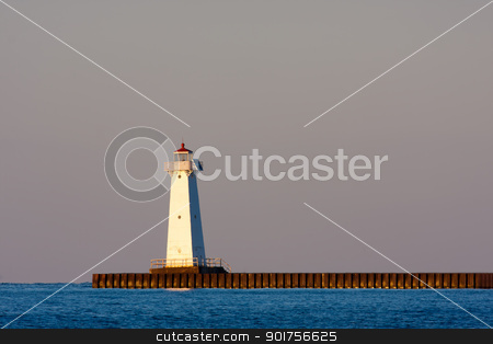 Sodus Bay Lighthouse stock photo, Sodus Bay Lighthouse on Lake Ontario in evening light at sunset by Stephen Bonk