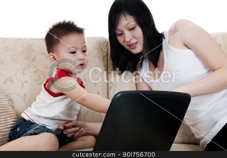 IT education. stock photo, Young mother with her son using a laptop by szefei