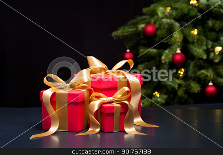 Three presents with gold ribbon stock photo, Three presents with gold ribbon in an elegant Christmas setting by Ulrich Schade