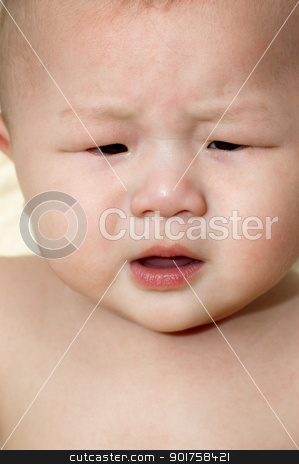 Crying baby. stock photo, An upset Asian baby boy is crying. by szefei