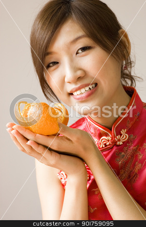 Happy Chinese New Year stock photo, Pretty asian with cheongsam wear holding a mandarin orange by szefei