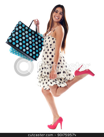 Its shopping time stock photo, Cute American woman with shopping bags. Smiling and having fun by Ishay Botbol