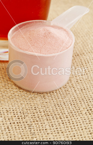 pomegranate powder and juice stock photo, measuring scoop of pomegranate fruit powder and glass of juice by Marek Uliasz