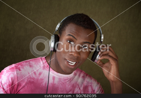 Young Man With Headphones stock photo, Young African-American Man Listening to Music on Large Earphones by Scott Griessel