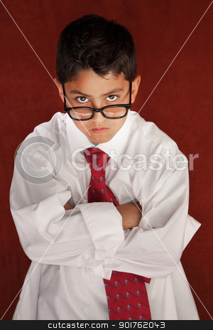 Daddy's Son stock photo, Cute young boy in his father's shirt and eyeglasses by Scott Griessel