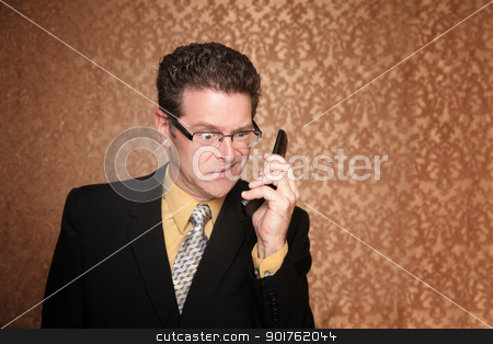 Angry Businessman with Cell Phone stock photo, Angry Business Man Hears Something Annoying on His Phone by Scott Griessel