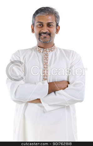 Confident Indian man stock photo, Confident mature traditional Indian man in kurta dhoti crossed arms isolated on white background by szefei
