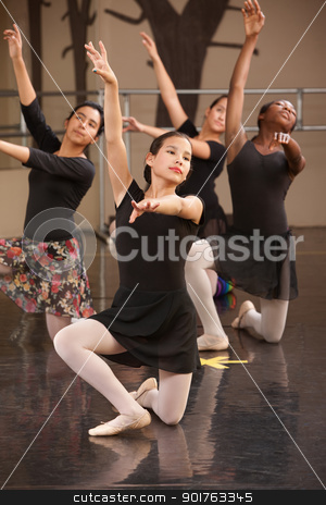 Ballet Group Kneeling stock photo, Four young ballet performers kneeling on floor by Scott Griessel