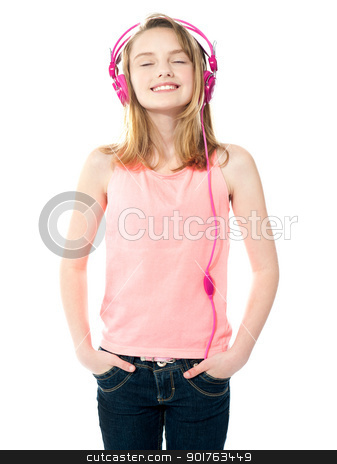 Come get lost in my musical world stock photo, Come get lost in my musical world. Trendy young girl posing by Ishay Botbol
