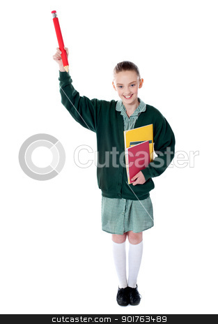 Pretty girl showing pencil upwards stock photo, Pretty girl showing pencil upwards with books in her hand by Ishay Botbol   