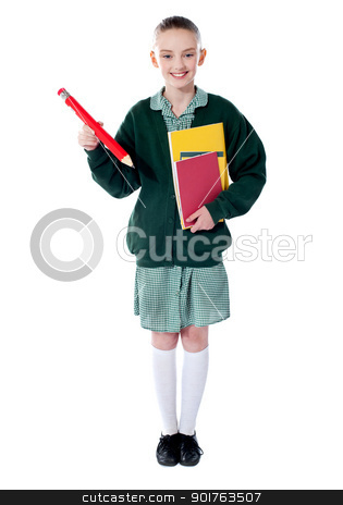 Full length portrait of blonde school girl stock photo, Full length portrait of blonde school girl holding big red pencil and notebooks by Ishay Botbol