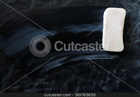 Blank smudged blackboard with eraser stock photo, Blank smudged blackboard background with eraser for text writing and design by John Young
