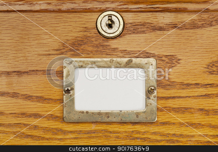 blank label of file cabinet drawer stock photo, blank label in brass holder on a wooden file cabinet drawer with a lock by Marek Uliasz
