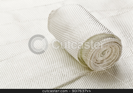 fiberglass cloth tape stock photo, a small roll of fiberglass cloth tape made of twisted strands of fiberglass with woven edges by Marek Uliasz