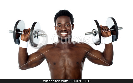 Male athlete holding dumbbells stock photo, Male athlete holding dumbbells above his shoulders by Ishay Botbol