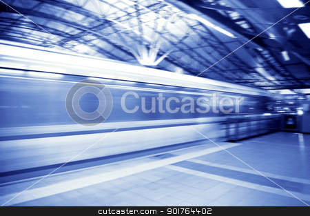 Speedy trains passing train station    stock photo, Speedy trains passing train station    by szefei