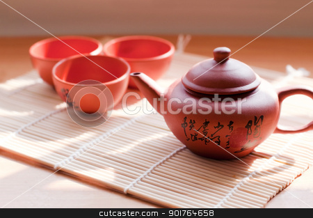 Chinese ceramic teapot and cups. stock photo, Chinese ceramic teapot and cups. The Chinese word on the pot is a poem. by szefei