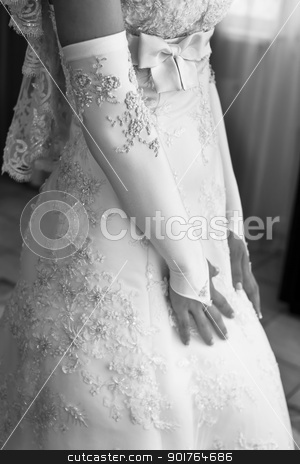 The bride in a beautiful dress stock photo, The bride in a beautiful dress with a veil stands at the window by sermax55
