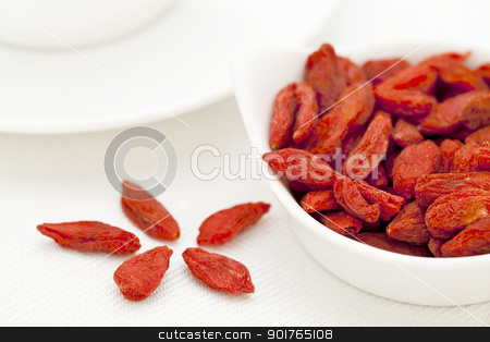 organic dried Tibetan goji berries stock photo, organic dried goji berries (wolfberry) in a small ceramic bowl - Tibetan superfood by Marek Uliasz