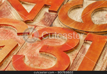 red number abstract stock photo, number abstract in vintage letterpress wood type stained by red and orange inks by Marek Uliasz