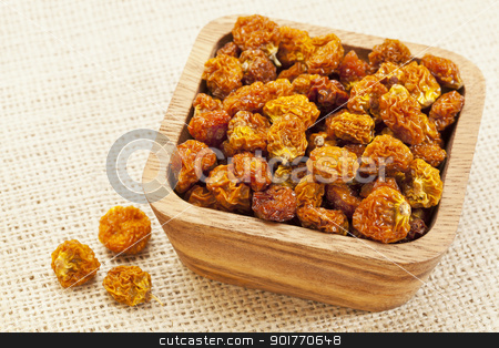 bowl of dried organic goldenberry stock photo, dried goldenberries (physalis peruviana,) , superfruit from Peru rich in antioxidnats, vitamin A, bioflavonoids, and dietary fiber, a wooden bowl by Marek Uliasz