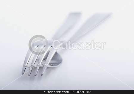Two forks stock photo, Two forks one over another overe white background by Fabio Alcini