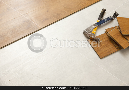 Hammer and Pry Bar with Laminate Flooring Abstract stock photo, Worn Hammer and Pry Bar with Laminate Flooring Abstract with Copy Room. by Andy Dean