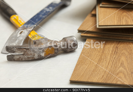 Hammer and Pry Bar with Laminate Flooring Abstract stock photo, Worn Hammer and Pry Bar with Laminate Flooring Abstract. by Andy Dean