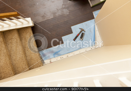 High Angle View of Hammer and Block with New Laminate Flooring stock photo, High Angle View of Hammer and Block with New Laminate Flooring Abstract. by Andy Dean