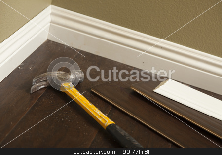 Hammer, Laminate Flooring and New Baseboard Molding stock photo, Hammer, Laminate Flooring and New Baseboard Molding Abstract. by Andy Dean