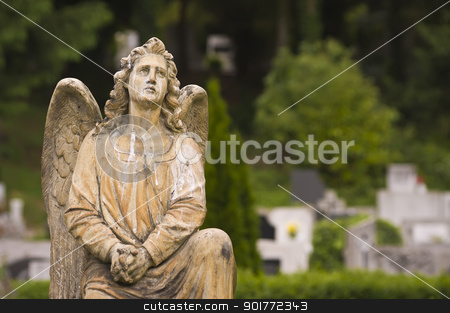 Angel statue stock photo, A prayer angel's statue in a cemetery. by Balazs Szabo