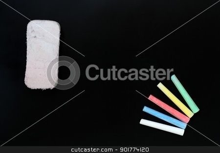 Colorful chalk and eraser on a blank blackboard stock photo, Blank blackboard background with colorful chalk and eraser for text writing and design by John Young