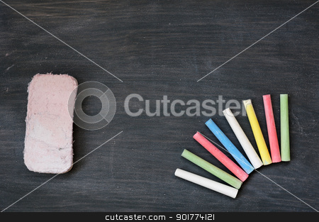 Colorful chalk and eraser on a blank smudged blackboard stock photo, Blank smudged blackboard background with colorful chalk and eraser for text writing and design by John Young