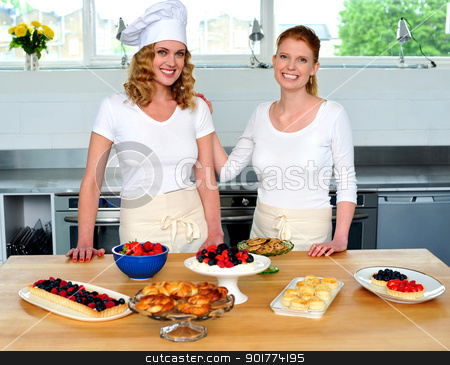 Professional chefs in commercial kitchen stock photo, Professional chefs in commercial kitchen. Delicious yummy snacks prepared by Ishay Botbol   