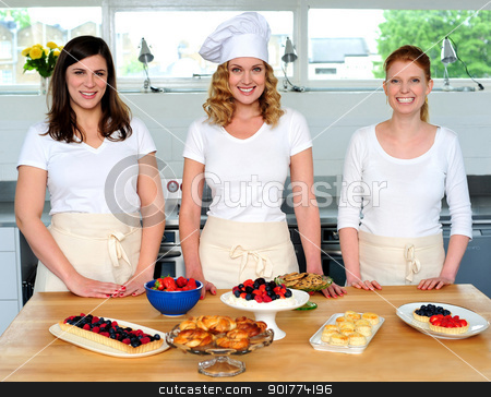 Team of confident chefs presenting snacks stock photo, Team of confident chefs presenting snacks. Fresh food decorated on table by Ishay Botbol