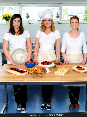 Female chefs decorating breakfast stock photo, Female chefs decorating breakfast. Ready to be served by Ishay Botbol