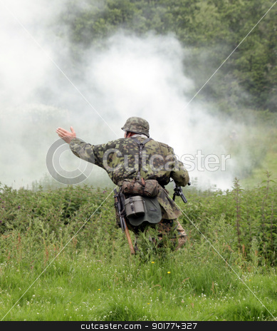 German paratroop soldier stock photo, German soldier from paratroop division in the heat of battle by Ollie Taylor