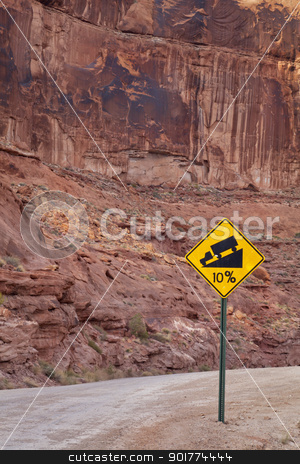 steep road sign stock photo, steep road with grade of 10 percent - a warning road sign in Canyonlands near Moab, Utah by Marek Uliasz