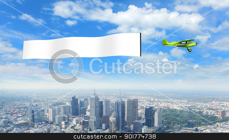 Plane and blank place stock photo, Plane in the sky above the city with blank flag by Sergey Nivens