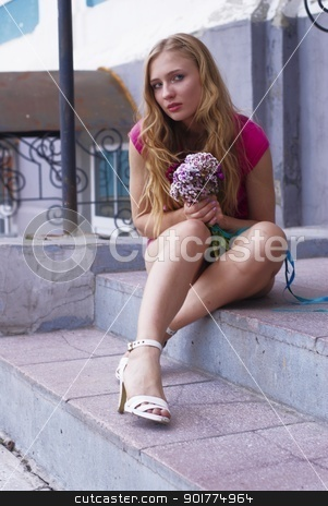 Pretty girl with bouquet stock photo, Young beautiful woman in pink with bouquet by Aikon