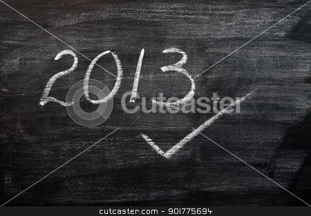 2013 written with chalk on a smudged blackboard stock photo, 2013 written in chalk on a smudged blackboard,with a tick by John Young