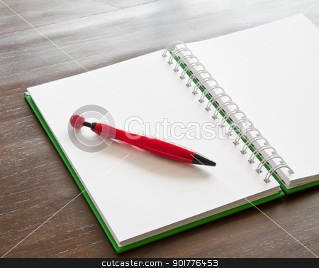 Pen and notepad on wooden table stock photo, Red pen and notepad on wooden table by thepoo