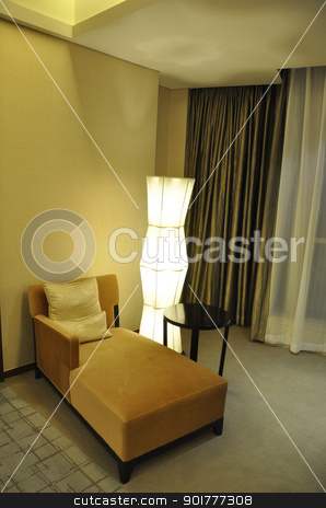 hotel sofa stock photo, an empty sofa in a luxury hotel with a light beside by momo_leif