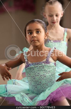 Cute Ballerina Friends stock photo, Two little girls in ballet dresses practice in a studio by Scott Griessel