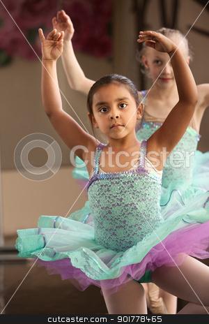 Two Ballerinas stock photo, Cute little girls in ballet dresses practice in a studio by Scott Griessel